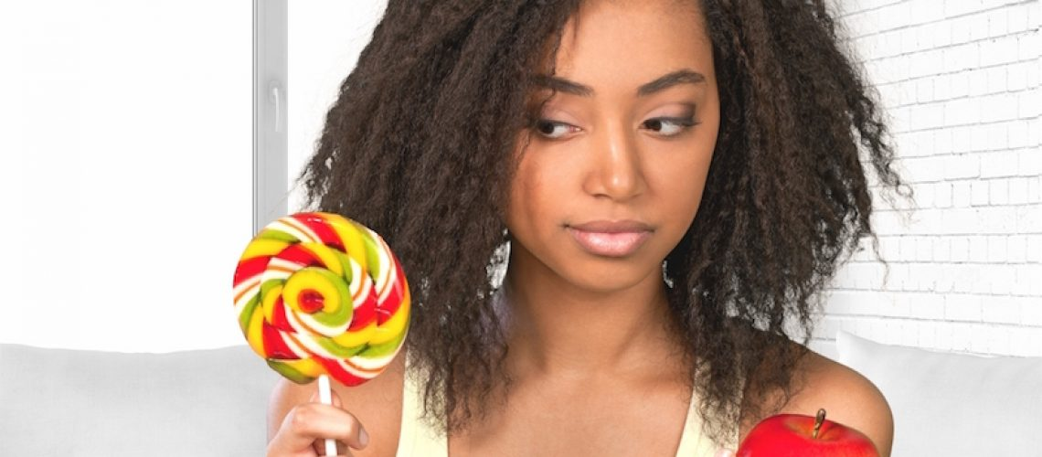 woman staring at candy suspiciously